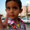Victory sign by a child whose father spent his days fighting outside of Misrata