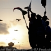 Young boys not old enough to fight celebrate the liberation of Misrata as the sunsets over the city