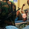 Chaos inside field hospital as fighters come to check on friends who have been injured during a siege