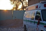 Ambulance parked next to field hospital as the drivers break from transporting injured from the frontline