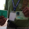 ID cards from young Gaddafi militia who were killed during battle and transported to the field hospital