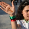 "A young girl showing ""Freedom"" written on her hand"