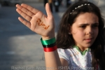 """A young girl showing """"Freedom"""" written on her hand"""