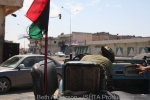 Fighter driving his open air jeep through the destroyed streets of Misrata