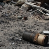 UXO (unexploded ordinance) outside a bombed apartment building