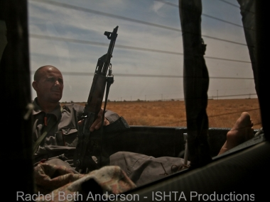 Barefoot fighter guarding the convoy during a scouting expedition onto Southern Misrata frontline