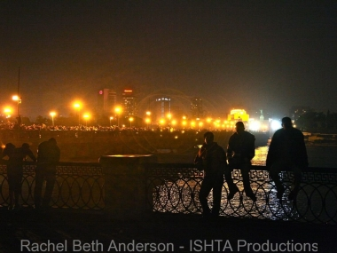 Protestors relax after crossing the bridge towards Tahrir Square