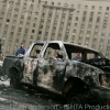 Burned out car inside Tahrir Square leftover from violence on Jan 28