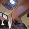 A group of men check out damage from inside a home recently hit by a rocket fired into the city by Gaddafi forces