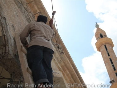 Volunteer fixing mosque bombed during siege