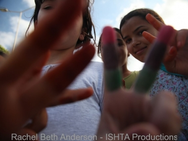 Children show victory sign during a citywide march