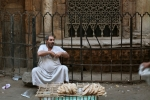 Selling bread in alleys of Old Cairo
