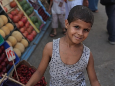 Local vegetable boy selling at market