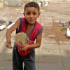 Young boy feeding pigeons in Islamic Cairo