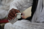 Tiny cup holding the most potent coffee called Jabana, a traditional Bedouin drink
