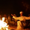 Taking a fireside bow for dance performance in Marsa Alam