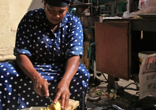 Prepping french fries at a street side vendor