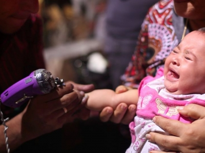 Young Coptic baby receives tattoo at traditional saint celebration