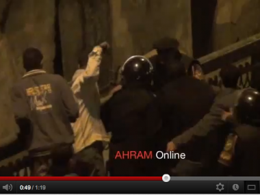 Police beat Egyptian protestor on Jan. 25, 2011
