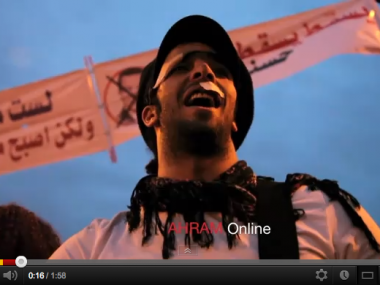 Rami Essam playing guitar in Tahrir during 2011 revolution