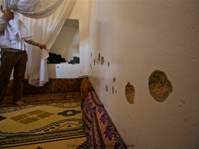 A man shows the room where 9 men were executed during an execution in Taftanaz.