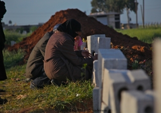 Mourning the death of their two sons who were members of the FSA and killed by government forces.