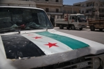 A truck inside the city of Marat Misrean in Northern Syria.