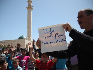 Speaking out, the people protest against president Assad after Friday prayer in Hozano.