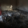 Remains of a home burned during early April attack in Idlib region.